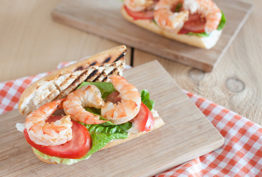 Homemade Shrimp Po Boy Sandwich with lettuce and tomatoes