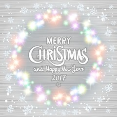 Merry Christmas and Happy New Year 2017. Glowing Christmas wreath made of led lights on the white wooden background. Christmas lights background.