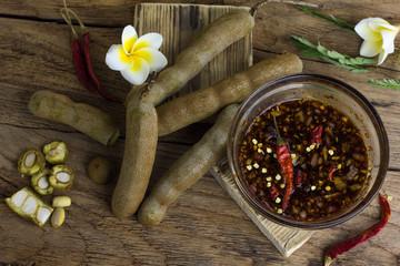 tamarind with Sweet fish sauce,tamarind agile sauce on old wood.