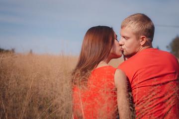 the loving couple walks on the wheat field