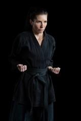 Female karate player performing karate stance