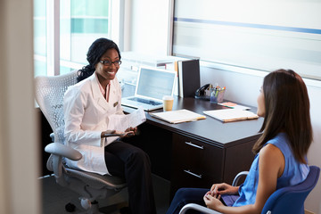 Doctor Wearing White Coat Meeting With Female Patient