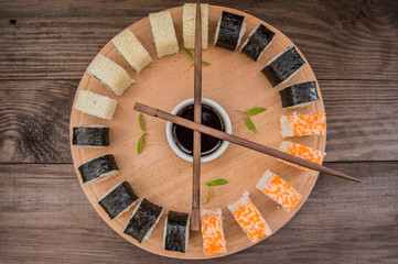 Sushi Set sashimi and  rolls on a wooden board.  background. Top view