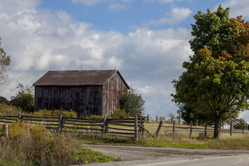 small barn by the side of the road