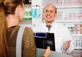 woman buys medicine