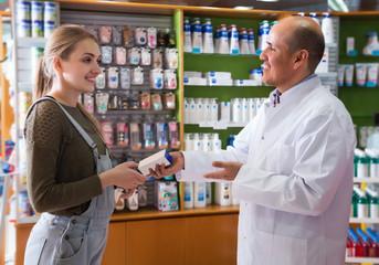 Female talking to a pharmacist