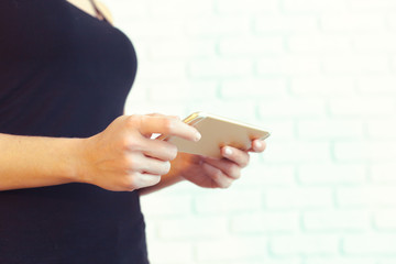 Woman with modern mobile phone in hands