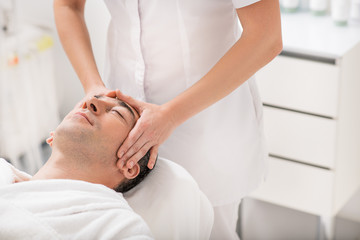 Businessman relaxing during massage at spa