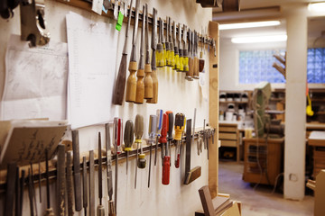 Work tools arranged on wall at workshop