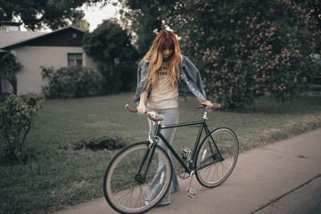 Woman with bicycle on footpath