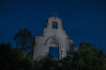 Low angle view of old abandoned church against sky at night
