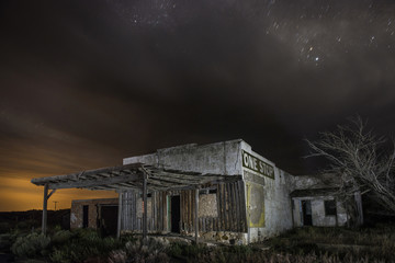 Abandoned house against sky at night
