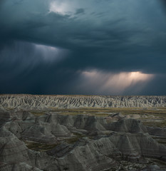 Scenic view of Badlands National Park against cloudscape
