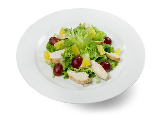 salad with grapes and chicken slices isolated on the white backg