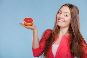 Fitness woman with grapefruit. Dieting slimming.