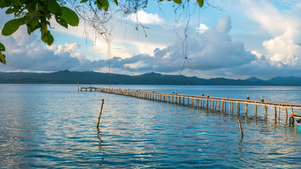 Pier of Dive Station - Kri Island. Clound above Gam in Background. Raja Ampat, Indonesia, West Papua