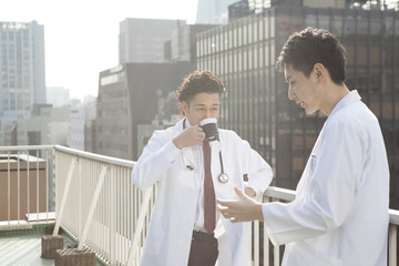 Male doctor is resting on the roof