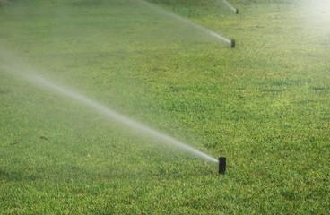 water springler in grass Field