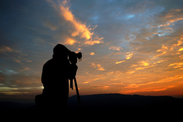 silhouette of a photographer taking pictures