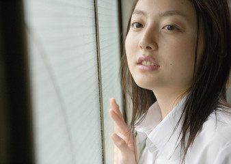 Girl by window in school uniform