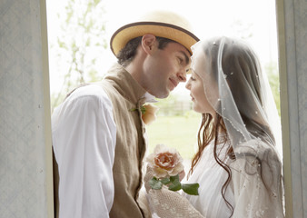 Bridal couple kissing