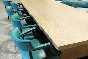 close up on table, chairs in meeting room