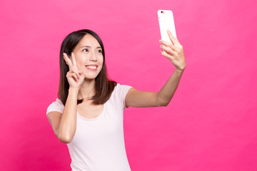 Young woman take selfie by mobile phone