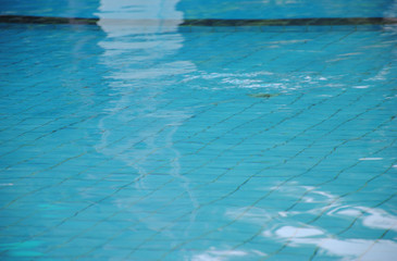 Pure blue water in the swimming pool. Water background.