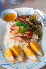 Stewed pork leg on rice,Thai food.