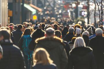 Crowd of people walking on a street