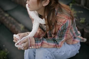 Young woman wearing white muffler