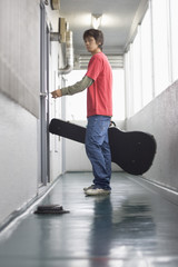 Young man opening front door