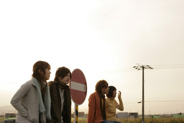 Young people and road sign