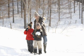 Father and children taking a walk