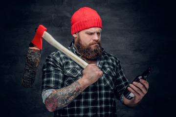 Bearded lumberjack drinking beer.