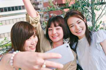 Three women taking a picture by themselves
