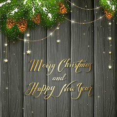 Golden stars and Christmas greeting on black wooden background