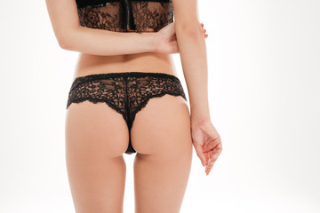 Back view portrait of a woman ass in black lingerie
