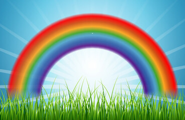 Bright rainbow blue sky with rising sun and green grass