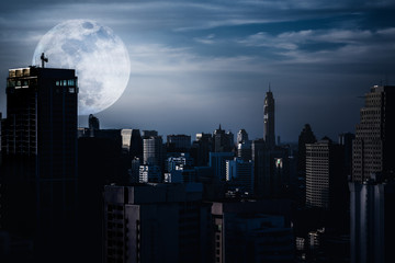 Silhouettes of skyscrapers different  construction with backgroud of a full moon Wall mural