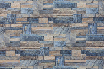 Wall from pieces of blue and beige marble