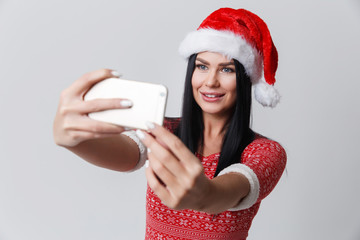 Woman in Christmas with smartphone