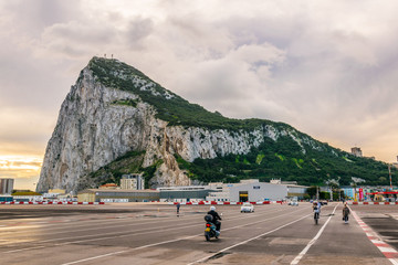 people are crossing border between spain and gibraltar during early morning