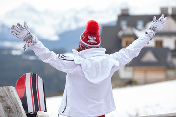 winter, leisure, sport and people concept - happy young woman in