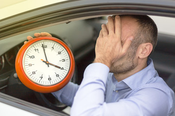 Businessman late stuck in traffic