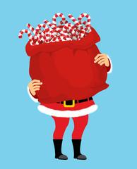 Santa Claus and bag of Christmas peppermint lollipop. Christmas