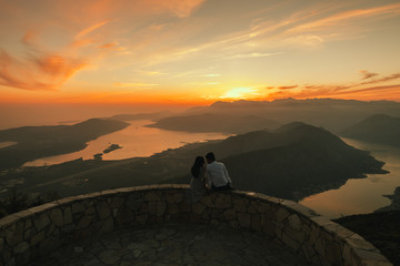 honeymoon couple kiss and embrace at sunset