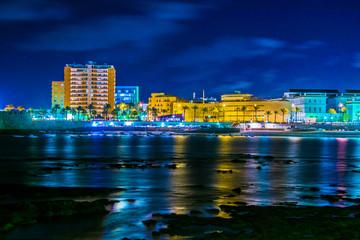night view of illuminated seaside promenade in the spanish city cadiz