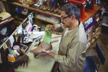Shoemaker repairing a shoe sole