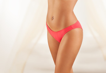 Image of female body in red panties.